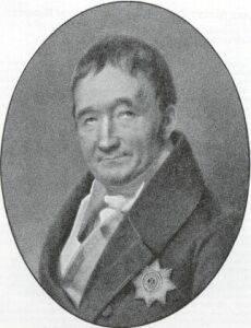 Schwarz Weiß Zeichnung eines Mannes in altertümlicher Kleidung. Er hat einen Stern als Brosche am Revers.